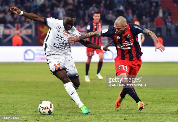 Montpellier's French forward Jonathan Ikone vies for the ball with Caen's French midfielder Vincent Bessat during the French L1 football match...