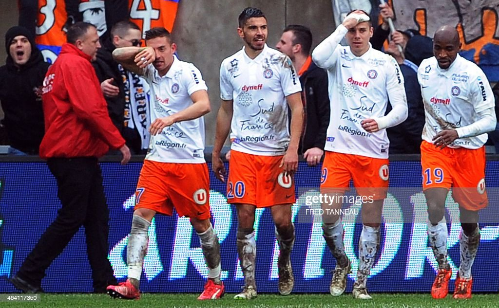 Montpellier's French forward Kevin Berigaud (2nd R) celebrateswith teammates after scoring a goal during the French L1 football match between Guingamp (EAG) and Montpellier (MHSC) on February 22, 2015 at the Roudourou stadium in Guingamp, western France.