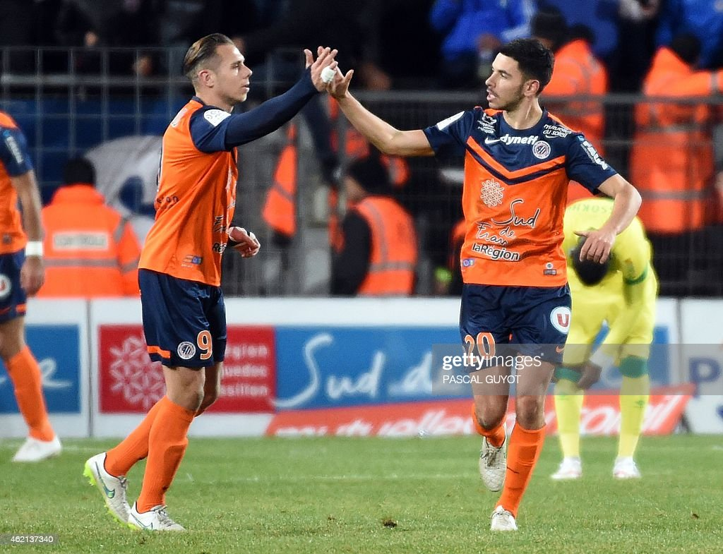 Montpellier's French forward Kevin Berigaud (L) reacts with his teammate French midfielder Morgan Sanson (R) after scoring during the French L1 football match between Montpellier and Nantes, on January 24, 2015 at the La Mosson Stadium in Montpellier, southern France. AFP PHOTO / PASCAL GUYOT