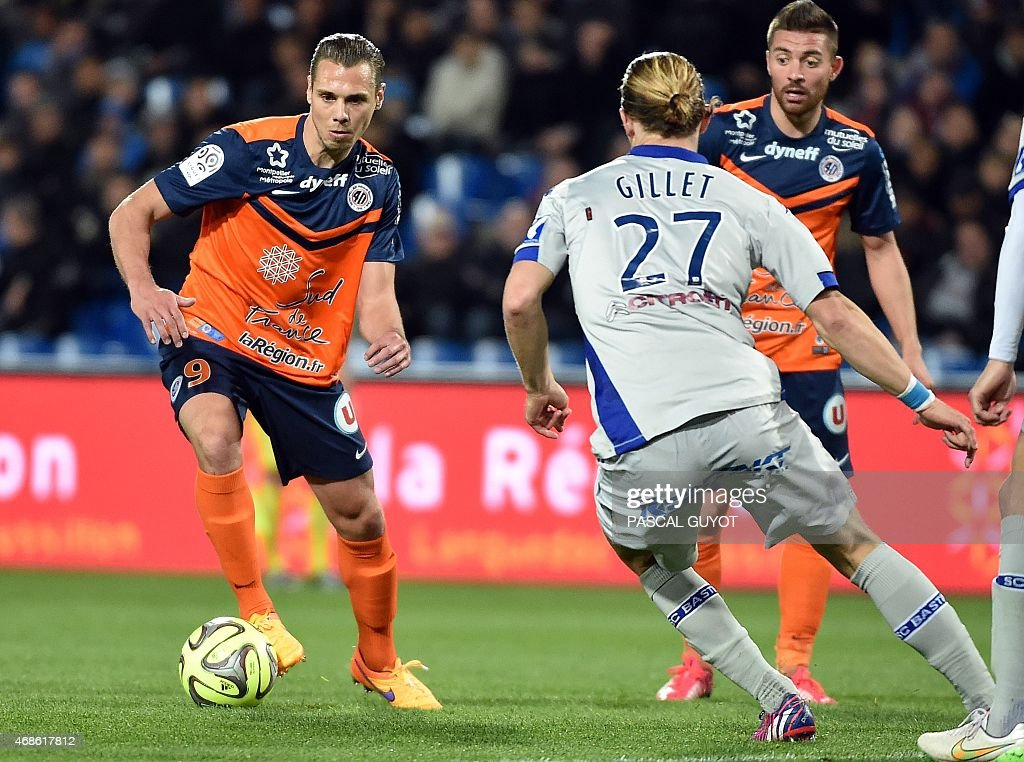 Montpellier's French forward Kevin Berigaud (L) vies with Bastia's French midfielder Guillaume Gilet (R) during the French L1 football match between Montpellier and Bastia, on April 04, 2015 at the La Mosson Stadium in Montpellier, southern France. AFP PHOTO / PASCAL GUYOT