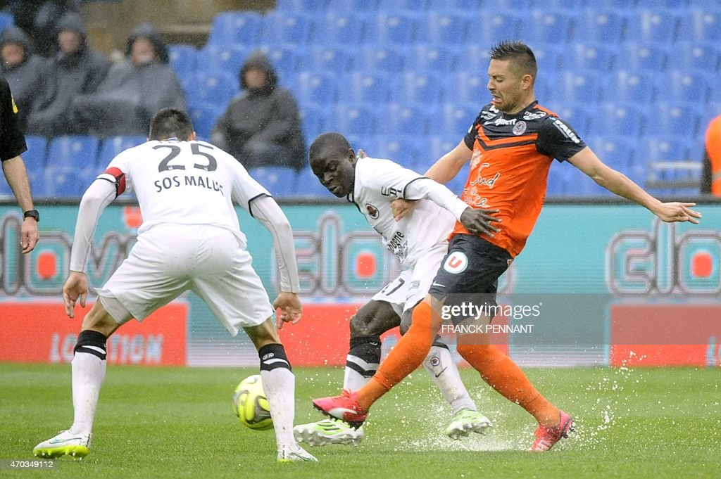 Montpellier's French forward Kevin Berigaud (R) vies with Caen's players during the French L1 football match between Montpellier and Caen at Mosson Stadium in Montpellier, southern France, on April 19, 2015. AFP PHOTO / FRANCK PENNANT
