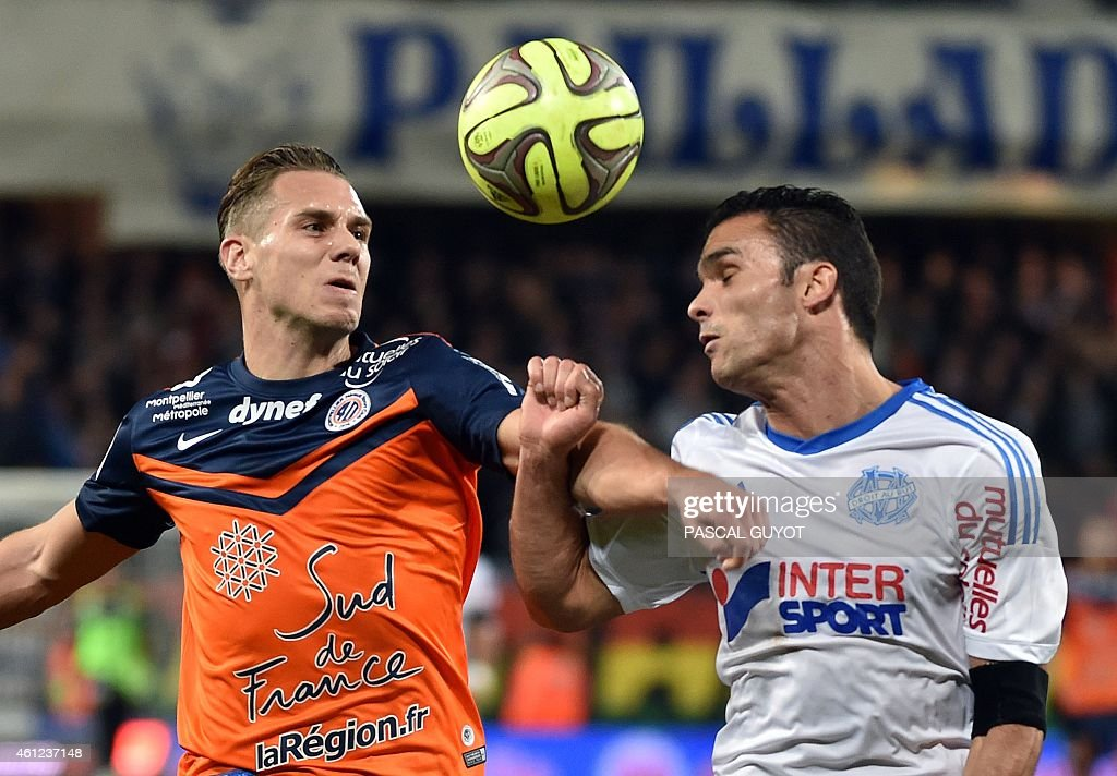 Montpellier's French forward Kevin Berigaud (L) vies with Marseille's French defender <a gi-track='captionPersonalityLinkClicked' href=/galleries/search?phrase=Jeremy+Morel&family=editorial&specificpeople=650503 ng-click='$event.stopPropagation()'>Jeremy Morel</a> (R) during the French L1 football match Montpellier vs Olympique de Marseille, on January 9, 2015 at the La Mosson Stadium in Montpellier, southern France. AFP PHOTO / PASCAL GUYOT