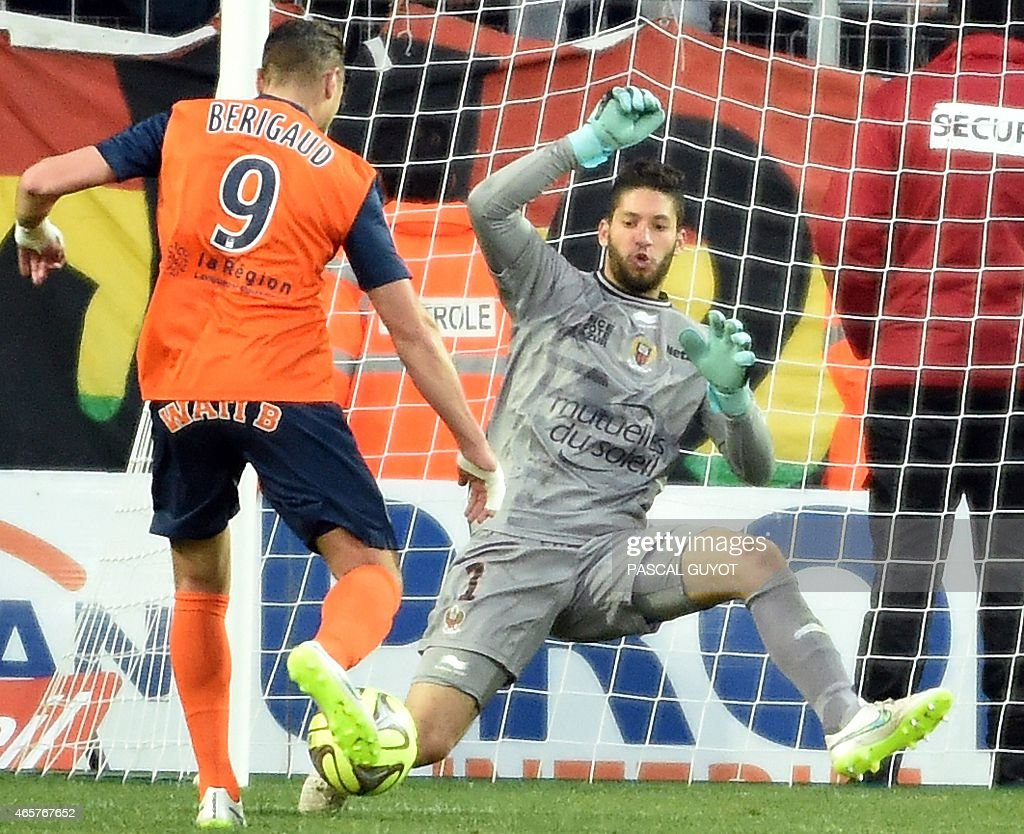 Montpellier's French forward Kevin Berigaud (L) vies with Nice's French goalkeeper Mouez Hassen (R) during the French L1 football match between Montpellier and Nice, on March 01, 2015 at La Mosson Stadium in Montpellier, southern France. AFP PHOTO / PASCAL GUYOT