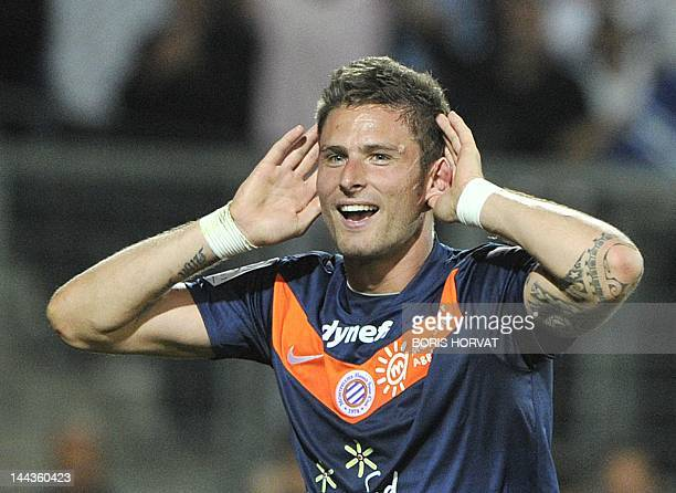 Montpellier's French forward Olivier Giroud celebrates after winning the French L1 football match Montpellier vs Lille on May 13 2012 at the Mosson...