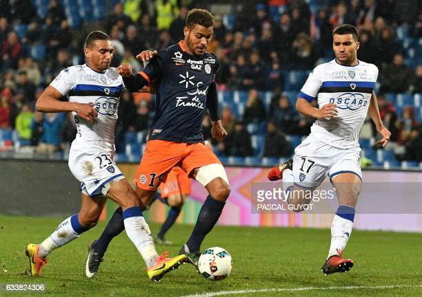 Montpellier's French forward Steve Mounié vies with Bastia's French defender Lindsay Rose and Bastia's French defender Alexander Djiku during the...