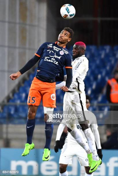 Montpellier's French forward Steve Mounié vies with Monaco's French midfielder Tiemoue Bakayoko during the French L1 football match between MHSC...