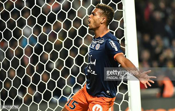 Montpellier's French forward Steve Mounie celebrates after scoring a goal during the French L1 football match between Montpellier and Marseille at...