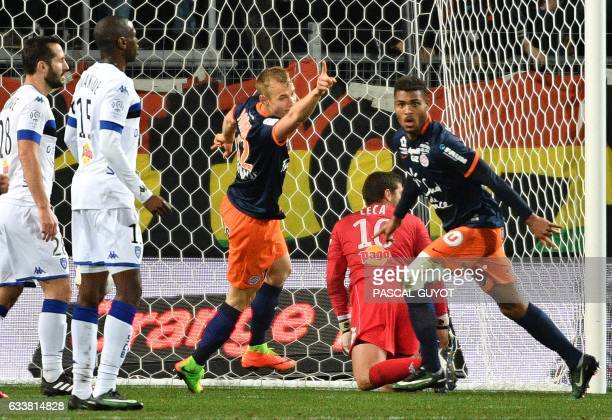 Montpellier's French forward Steve Mounie reacts after scoring a goal during the French L1 football match between MHSC Montpellier and Bastia on...