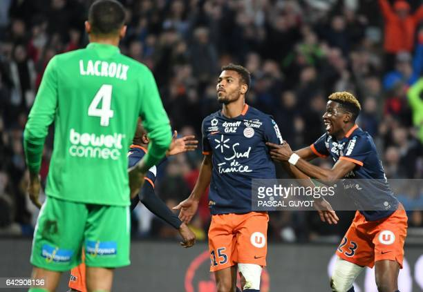Montpellier's French forward Steve Mounie reacts after scoring a goal during the French L1 football match between MHSC Montpellier and AS Saint...