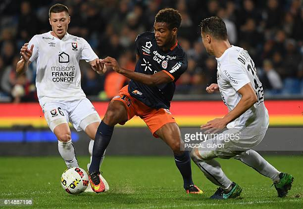 Montpellier's French forward Steve Mounie vies with Caen's French defender Damien Da Silva and Caen's French midfielder Jonathan Delaplace during the...