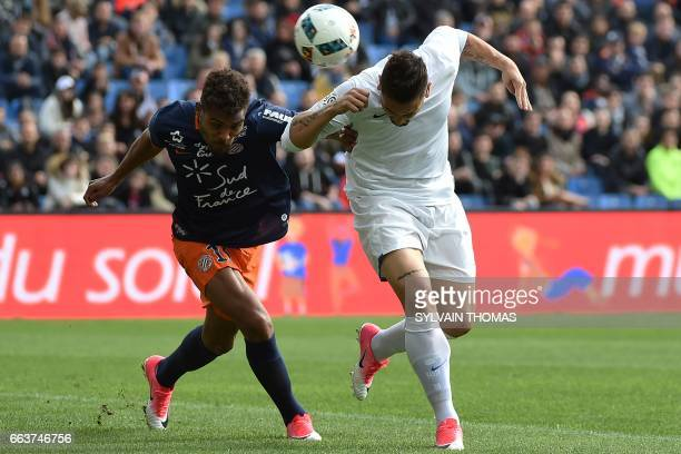 CORRECTION Montpellier's French forward Steve Mounie vies with Toulouse's French forward Andy Delort during the French L1 football match between...