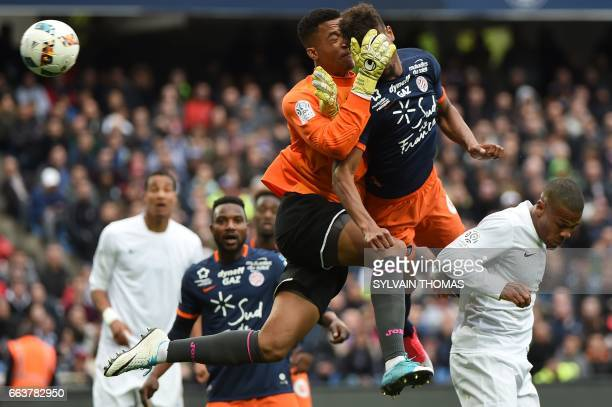 Montpellier's French forward Steve Mounie vies with Toulouse's french goalkepper Alban Lafont during the French L1 football match Montpellier vs...