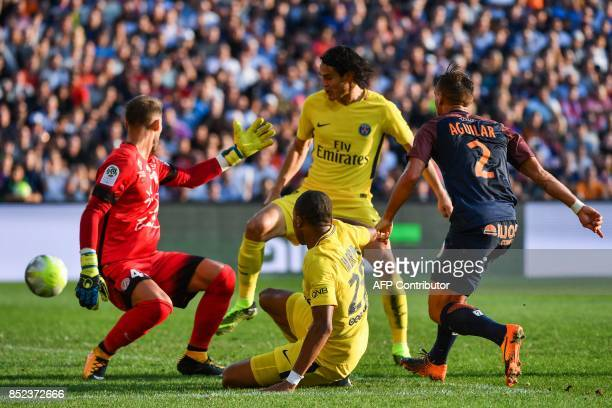 Montpellier's French goalkeeper Benjamin Lecomte and Montpellier's French defender Ruben Aguilar defend against Paris SaintGermain's French forward...