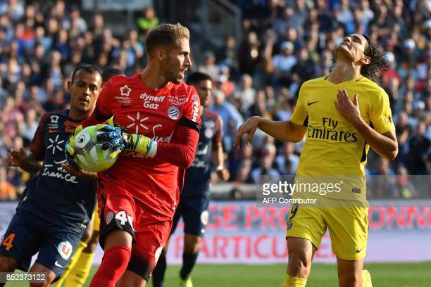 Montpellier's French goalkeeper Benjamin Lecomte grabs the ball ahead of Paris SaintGermain's Uruguayan forward Edinson Cavani during the French...