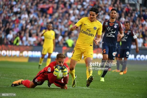 Montpellier's French goalkeeper Benjamin Lecomte grabs the ball ahead of Paris SaintGermain's Uruguayan forward Edinson Cavani during the French...