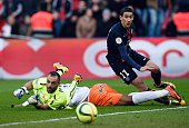 Montpellier's French goalkeeper Laurent Pionnier falls next to Paris SaintGermain's Argentinian forward Angel Di Maria during the French L1 football...