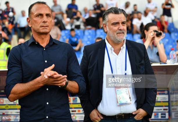 Montpellier's French head coach Michel Der Zakarian and Montpellier's French club president Laurent Nicollin look on during the French L1 football...