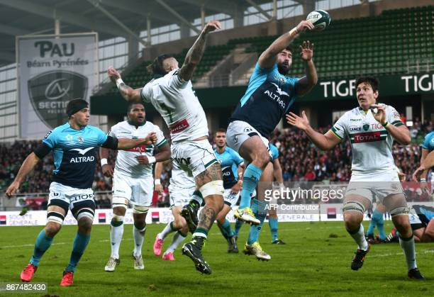 Montpellier's French hooker Romain Ruffenach jumps to grab the ball during the French Top 14 rugby union match between Pau and Montpellier at the...