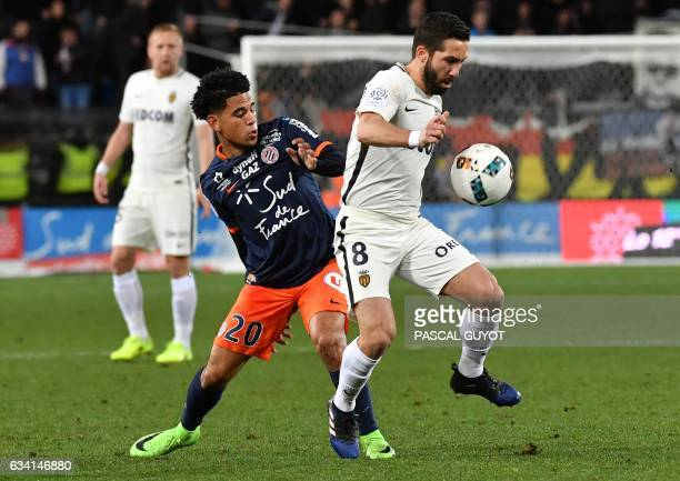 Montpellier's French Keagan Dolly vies with Monaco's Portuguese midfielder Joao Moutinho during the French L1 football match between MHSC Montpellier...