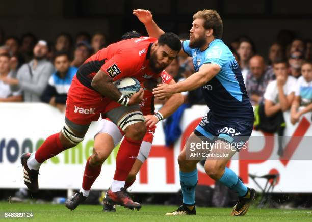 Montpellier's French lock Paul Willemse vies with RC Toulon's French prop Sébastien Taofifenua during the French Top 14 rugby union match between...