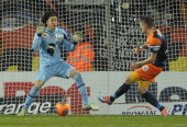 Montpellier's French midfielder Anthony Mounier scores a goal past Ajaccio's Mexican goalkeeper Guillermo Ochoa during the French L1 football match...