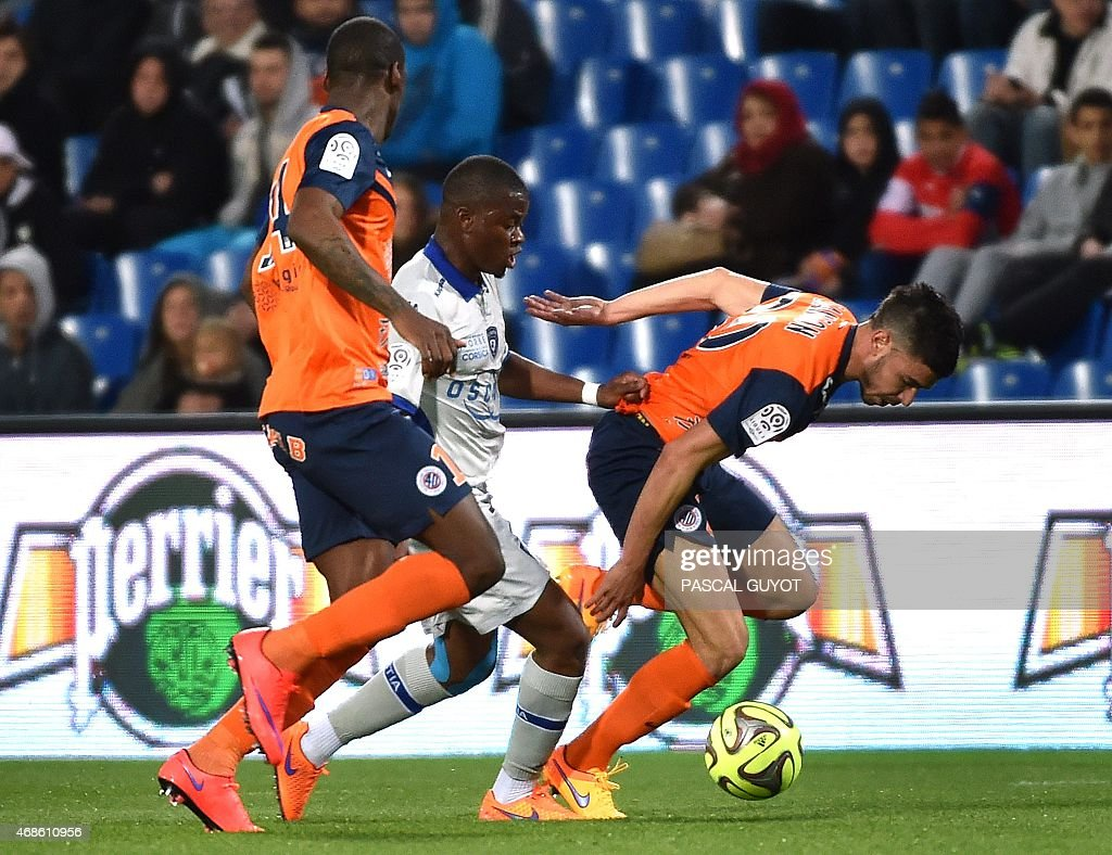 Montpellier's French midfielder Bryan Dabo (L) and Montpellier's French midfielder <a gi-track='captionPersonalityLinkClicked' href=/galleries/search?phrase=Morgan+Sanson&family=editorial&specificpeople=10104687 ng-click='$event.stopPropagation()'>Morgan Sanson</a> (R) vies with Bastia's French midfielder <a gi-track='captionPersonalityLinkClicked' href=/galleries/search?phrase=Floyd+Ayite&family=editorial&specificpeople=5969808 ng-click='$event.stopPropagation()'>Floyd Ayite</a> (C) during the French L1 football match between Montpellier and Bastia, on April 4, 2015 at La Mosson Stadium in Montpellier, southern France.
