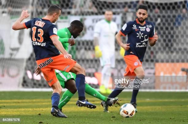 Montpellier's French midfielder Ellyes Skhiri and Montpellier's French midfielder Ryad Boudebouz vies with SaintEtienne's French midfielder Yohan...
