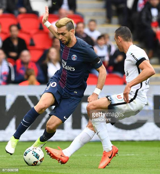 Montpellier's French midfielder Ellyes Skhiri vies with Paris SaintGermain's Argentinian forward Javier Pastore during the French L1 football match...