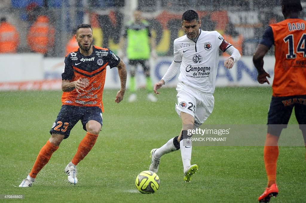 Montpellier's French midfielder Jamel Saihi (L) vies with Caen's French midfielder <a gi-track='captionPersonalityLinkClicked' href=/galleries/search?phrase=Julien+Feret&family=editorial&specificpeople=4110266 ng-click='$event.stopPropagation()'>Julien Feret</a> during the French L1 football match between Montpellier and Caen at Mosson Stadium in Montpellier, southern France, on April 19, 2015.