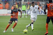 Montpellier's French midfielder Jamel Saihi vies with Caen's French midfielder Julien Feret during the French L1 football match between Montpellier...