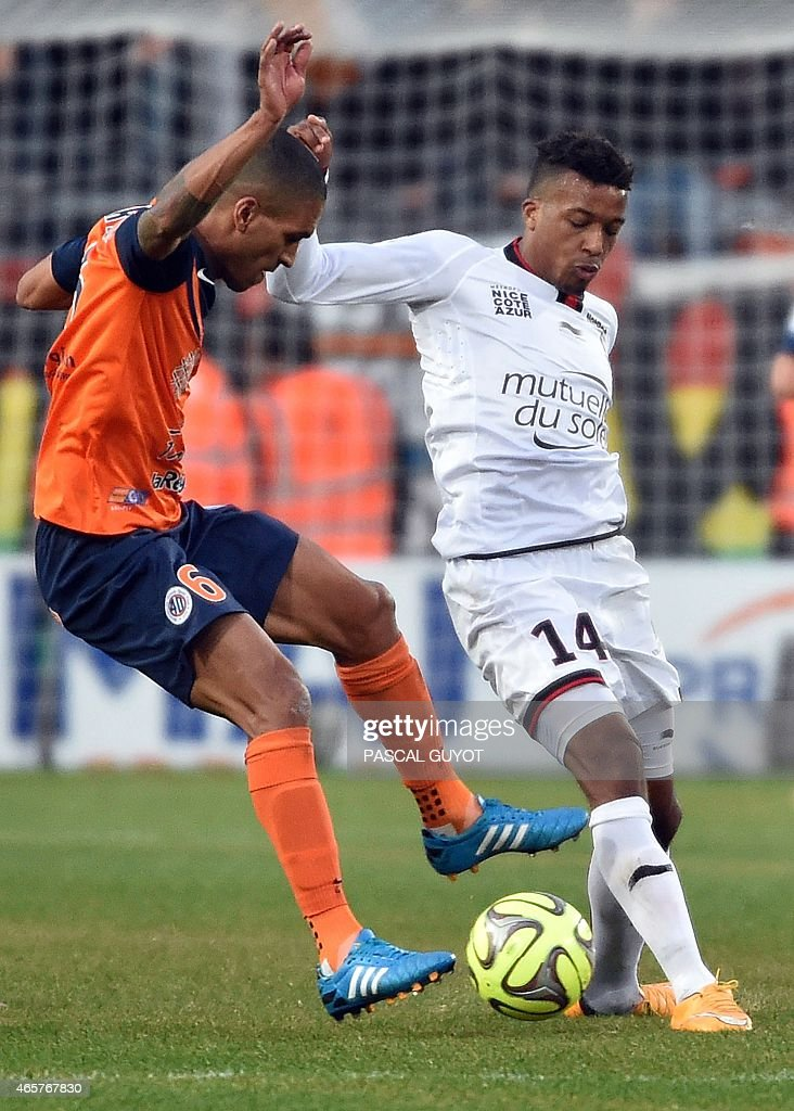 Montpellier's French midfielder Joris Marveaux (L) vies with Nice's French forward Alassa Plea (R) during the French L1 football match between Montpellier and Nice, on March 01, 2015 at La Mosson Stadium in Montpellier, southern France.