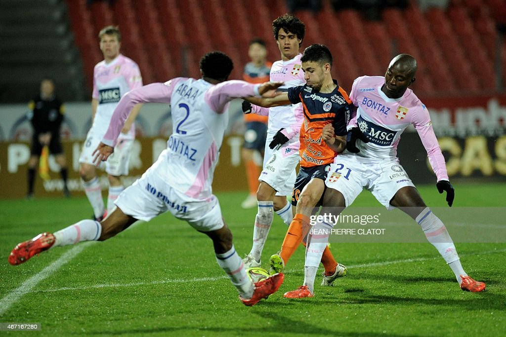 Montpellier's French midfielder <a gi-track='captionPersonalityLinkClicked' href=/galleries/search?phrase=Morgan+Sanson&family=editorial&specificpeople=10104687 ng-click='$event.stopPropagation()'>Morgan Sanson</a> (2nd R) vies with Evian's Comorian defender Kassim Abdallah (L), Evian's Congolese defender <a gi-track='captionPersonalityLinkClicked' href=/galleries/search?phrase=Cedric+Mongongu&family=editorial&specificpeople=4305033 ng-click='$event.stopPropagation()'>Cedric Mongongu</a> (R) and Evian's Costa Rican midfielder <a gi-track='captionPersonalityLinkClicked' href=/galleries/search?phrase=Yeltsin+Tejeda&family=editorial&specificpeople=7624398 ng-click='$event.stopPropagation()'>Yeltsin Tejeda</a> (2nd L) during the French L1 football match between Evian and Montpellier on march 21, 2015 at the Parc des Sports stadium in Annecy, southern, France. AFP PHOTO / JEAN-PIERRE CLATOT