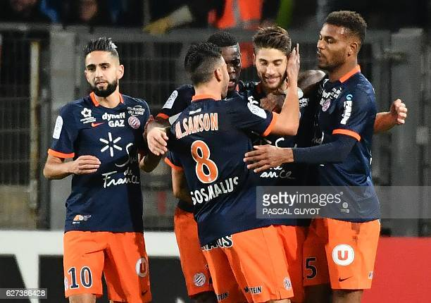 Montpellier's French midfielder Paul Lasne is congratuled by his teammates after scoring a goal during the French L1 football match between MHSC...