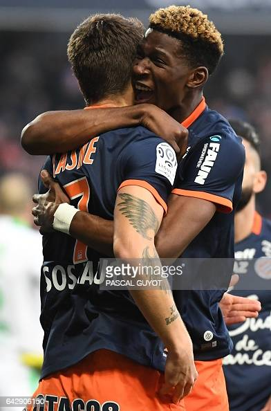 Montpellier's French midfielder Paul Lasne is congratuled by his teamates Montpellier's French defender Nordi Mukiele after scoring a goal during the...