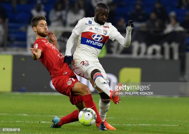 Montpellier's French midfielder Paul Lasne vies with Lyon's French defender Tanguy Ndombele during the French L1 football match Lyon vs Montpellier...