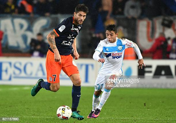 Montpellier's French midfielder Paul Lasne vies with Olympique de Marseille's French midfielder Maxime Lopez during the French L1 football match...
