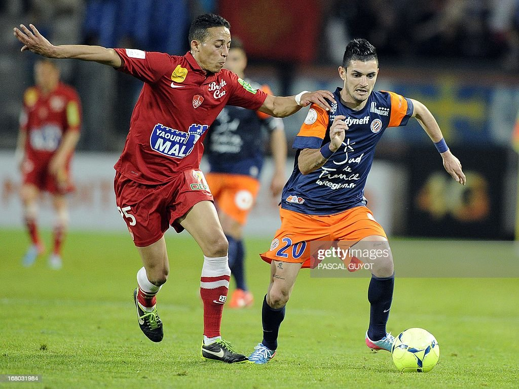 Montpellier's French midfielder Remy Cabella (R) vies for the ball with Brest's Moroccan midfielder Kamel Chafni (L) during the French L1 football match Montpellier vs Brest on May 4, 2013 at the Mosson stadium in Montpellier, southern France. AFP PHOTO / PASCAL GUYOT
