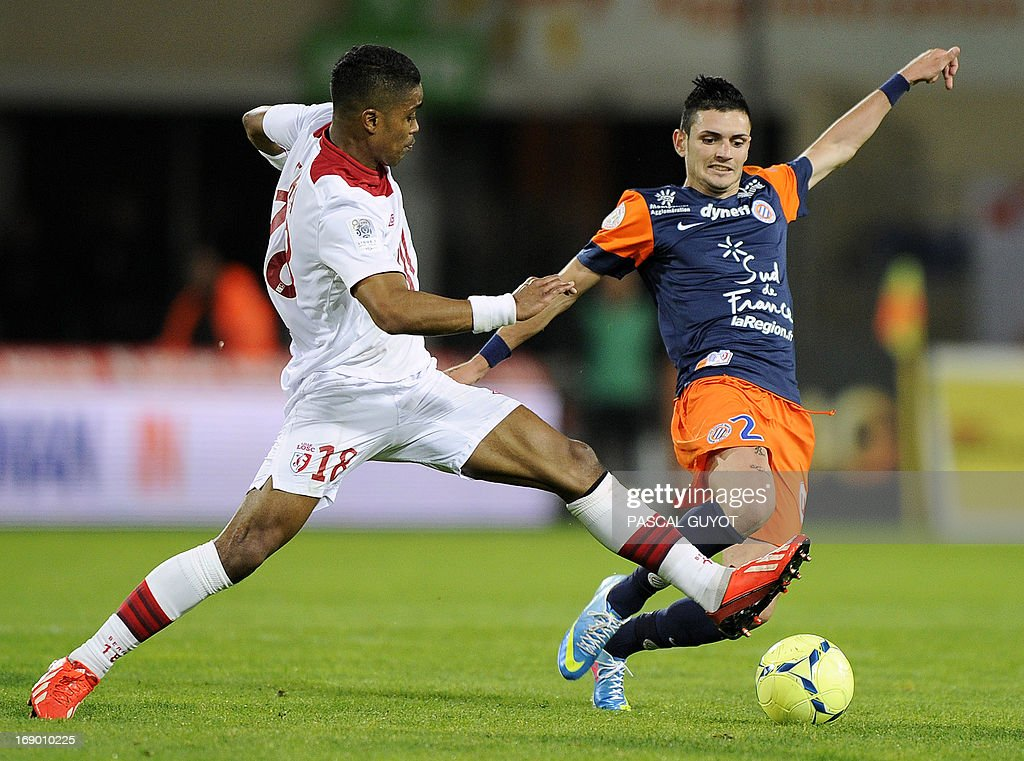 Montpellier's French midfielder Remy Cabella (L) vies for the ball with Lille's French defender Franck Beria (L) during the French L1 football match Montpellier vs Lille on May 18, 2013 at the Mosson stadium in Montpellier, southern France.