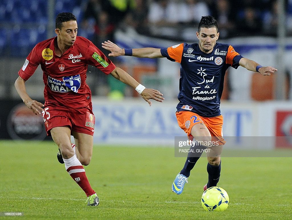 Montpellier's French midfielder Remy Cabella (R) vies with Brest's Moroccan midfielder Kamel Chafni (L) during the French L1 football match Montpellier vs Brest on May 4, 2013 at the Mosson stadium in Montpellier, southern France.