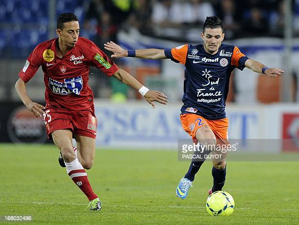 Montpellier's French midfielder Remy Cabella vies with Brest's Moroccan midfielder Kamel Chafni during the French L1 football match Montpellier vs...