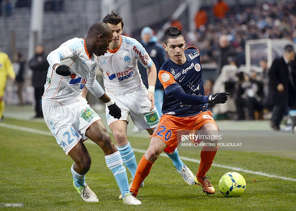 Montpellier's French midfielder Remy Cabella (R) vies with Marseille's French defender Fanni Rod (L) after scoring a goal during the French L1 football match Marseille (OM) vs Montpellier (MHSC) on January 19, 2013 at the Velodrome stadium in Marseille, southern France.