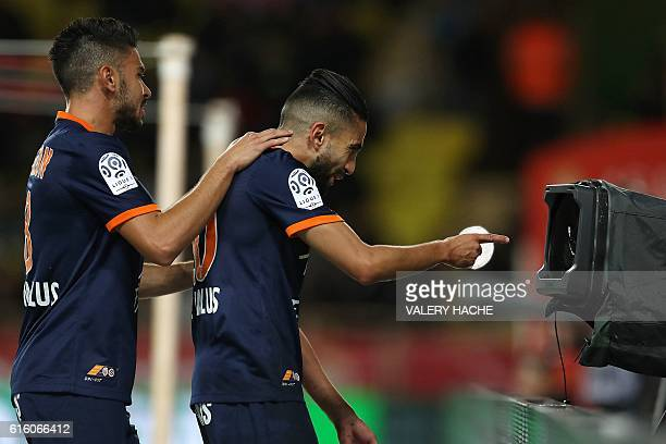 TOPSHOT Montpellier's French midfielder Ryad Boudebouz celebrates after scoring a goal during the French L1 football match between AS Monaco and...