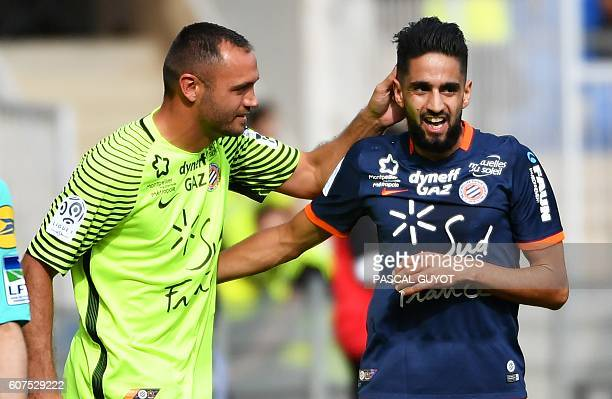 Montpellier's French midfielder Ryad Boudebouz is congratulated by his teammate French goalkeeper Laurent Pionnier after scoring a goal during the...
