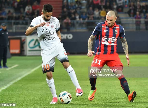 Montpellier's French midfielder Ryad Boudebouz vies for the ball with Caen's French midfielder Vincent Bessat during the French L1 football match...