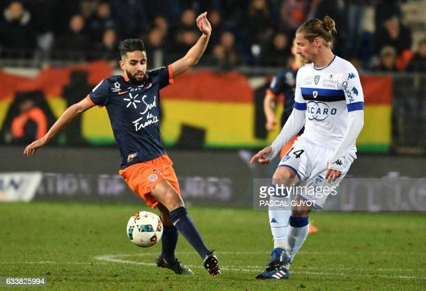 Montpellier's French midfielder Ryad Boudebouz vies with Bastia's Algerian midfielder Mehdi Mostefa during the French L1 football match between MHSC...
