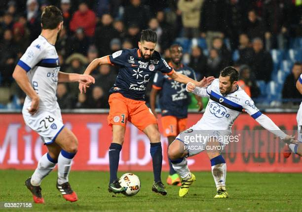 Montpellier's French midfielder Ryad Boudebouz vies with Bastia's French defender Gilles Cioni and Bastia's French defender Florian Marange during...