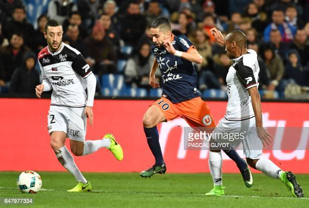 Montpellier's French midfielder Ryad Boudebouz vies with Guingamp's French defender Jeremy Sorbon and Guingamp's FrenchPortuguese defender Jonathan...