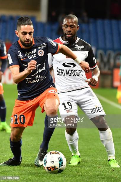 Montpellier's French midfielder Ryad Boudebouz vies with Guingamp's French midfielder Yannis Salibur during the French L1 football match between MHSC...