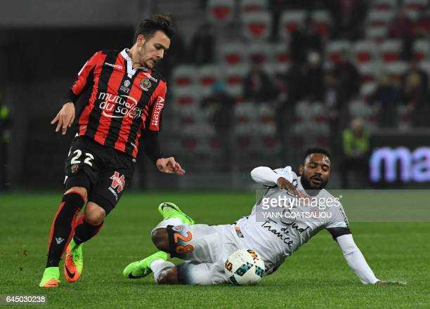 Montpellier's French midfielder Stephane Sessegnon falls next to Nice's Greek forward Anastasios Donis during the French L1 football match OGC Nice...