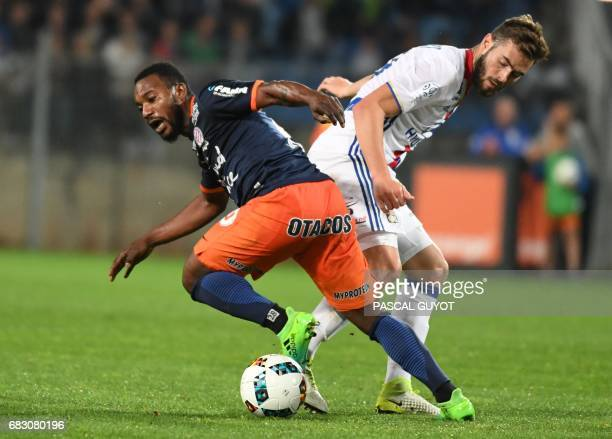 Montpellier's French midfielder Stephane Sessegnon vies with Lyon's French midfielder Lucas Tousart during the French L1 football match between...